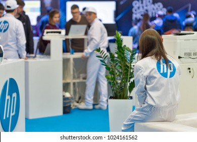 KIEV, UKRAINE - OCTOBER 08, 2017: People visit Hewlett-Packard, American multinational information technology company booth at CEE 2017, largest electronics trade show of Ukraine in KyivExpoPlaza EC.