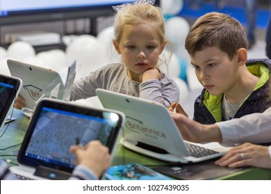 KIEV, UKRAINE - OCTOBER 08, 2017: Kids visit Microsoft, American multinational technology company booth during CEE 2017, the largest consumer electronics trade show of Ukraine in KyivExpoPlaza EC.