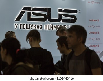 KIEV, UKRAINE - OCTOBER 08, 2017: People visit Asus, a Taiwan based international computer company booth during CEE 2017, the largest electronics trade show of Ukraine in ExpoPlaza Exhibition Center.