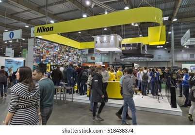 KIEV, UKRAINE - OCTOBER 09, 2016: Unrecognized visitors testing professional photographic cameras on Nikon booth during CEE 2016, the largest electronics trade show of Ukraine in KyivExpoPlaza EC.