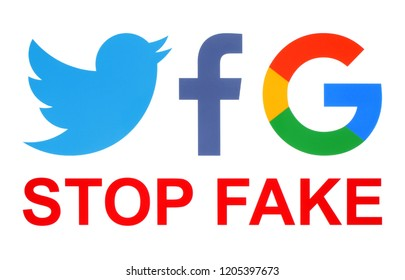 Kiev, Ukraine - October 09, 2018: Facebook, Twitter and Google icons printed on white paper with stop fake words. Facebook, Twitter and Google agree to fight fake news in the EU.