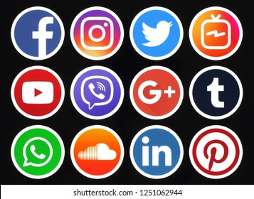 Kiev, Ukraine - October 09, 2018: Popular circle social media icons with white rim on black background printed on paper: Facebook, Twitter, Instagram, Pinterest, LinkedIn, Viber, Tumblr and others