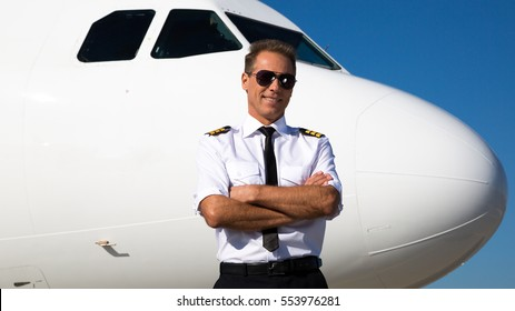 Kiev, Ukraine - OCTOBER 10, 2014: Airline pilot standing near aircraft. Pilot's uniform. Airport. Aviation theme.