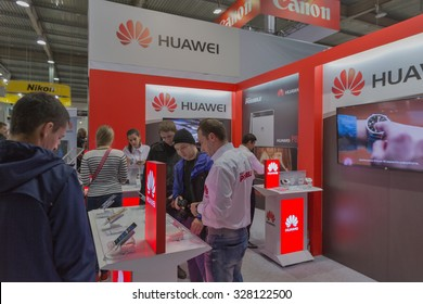 KIEV, UKRAINE - OCTOBER 11, 2015: People visit Huawei, Chinese  electronics manufacturer company booth during CEE 2015, the largest electronics trade show of Ukraine in ExpoPlaza Exhibition Center
