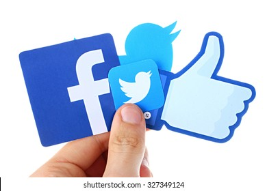 KIEV, UKRAINE - OCTOBER 12, 2015. Facebook, twitter in hand. Hand holding popular social media icons