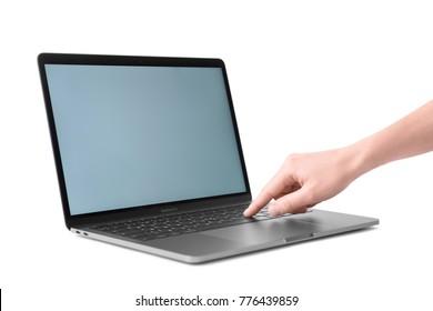 KIEV, UKRAINE - OCTOBER 13, 2017: Woman touching Apple space gray MacBook Pro on white background
