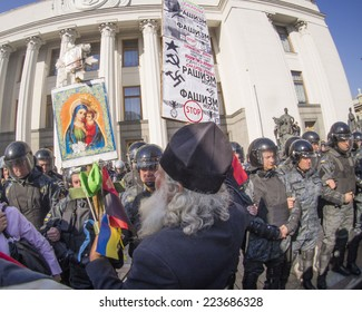 """KIEV , UKRAINE - October 14, 2014: """"Right sector"""" and """"Freedom"""" disown provocations at the Verkhovna Rada. About 30 protesters started throwing soldiers of the National Guard cobblestones"""