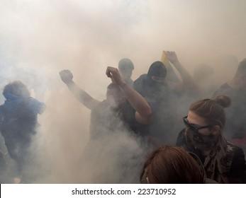 KIEV , UKRAINE - October 14, 2014: Clashes near Verkhovna Rada. Protesters use smoke bombs.