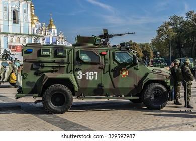 "KIEV, UKRAINE - OCTOBER 14, 2015: Exhibition ""Power of Unbroken"" on Mykhailivska Square on Day of Defender of Ukraine. Soldiers of the National Guard exhibit military equipment."