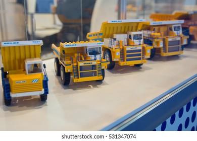 Kiev, Ukraine - October 14, 2016: Models of Belaz dump trucks production at the exhibition stand MiningWorld Ukraine 2016
