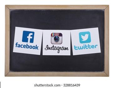 KIEV, UKRAINE - OCTOBER 15, 2015:Facebook, Twitter; Instagram logos printed on paper and placed on a blackboard.