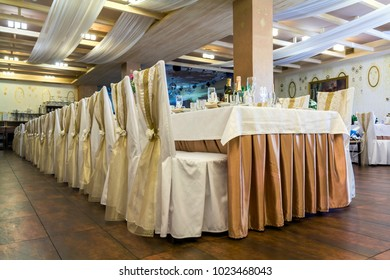 Kiev, Ukraine - October 15, 2017: Wedding hall or other function facility set for fine dining. Rows of tables and chairs decorated for holiday meal. Interior of modern restaurant.