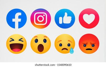 Kiev, Ukraine - October 15, 2019:  Instagram, new Facebook like button  Empathetic Emoji reactions printed on paper.