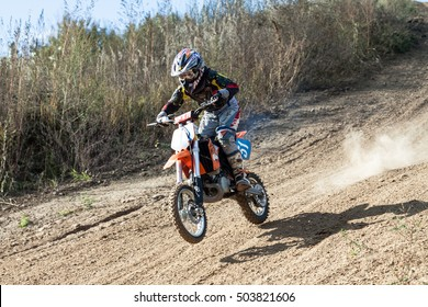 Kiev, Ukraine - October 17, 2016: Kid on motorcycle going thru dirt, during Championship of Ukraine on cross-country final stage.