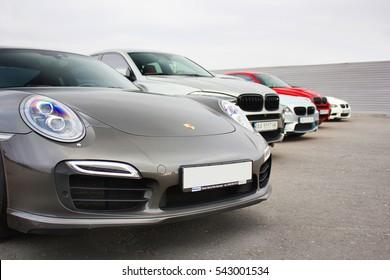Kiev, Ukraine; October 17, 2016; Super combo supercars. Porsche 911 Turbo S & 2x BMW X6 M & BMW M3 (E92). Street racing.  Drag racing. Editorial photo.