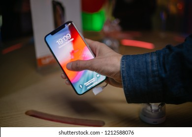 "Kiev, Ukraine - October 19, 2018: sales start of Iphone XS / XS Max, Iphone Xr in Ukraine in the shop ""Citrus"". New iphone Xs / Xr on the shop window. A man holds in his hands a new Iphone Xs."