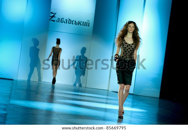 "KIEV, UKRAINE - OCTOBER 19: Fashion model wears clothes created by ""Vktor ZAVADS'KII"" at the 24th Ukrainian Fashion Week on Oct. 19, 2009 in Kiev, Ukraine."