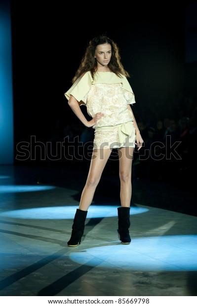 "KIEV, UKRAINE - OCTOBER 19: Fashion model wears clothes created by ""Vktor ZAVADS'KII"" at the 24th Ukrainian Fashion Week on Oct. 19, 2009 in Kiev, Ukraine."