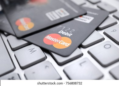KIEV, UKRAINE - OCTOBER 2, 2017: MasterCard credit cards on keyboard