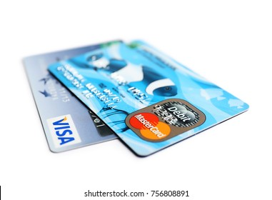 KIEV, UKRAINE - OCTOBER 2, 2017: Visa and MasterCard credit cards on white background