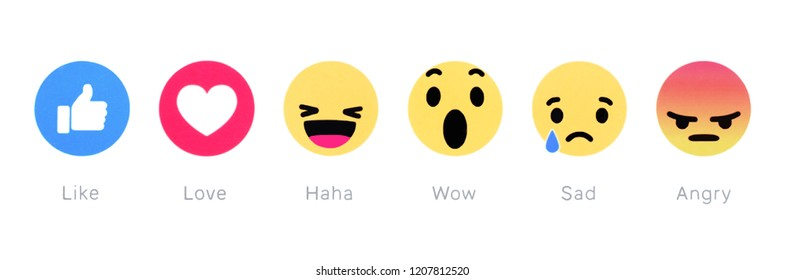 Kiev, Ukraine - October 20, 2018: Facebook like button and Empathetic Emoji Reactions printed on white paper. Facebook is a well-known social networking service.