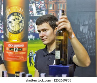 KIEV, UKRAINE - OCTOBER 20, 2018: Presenter works at Glen Scotia Scotch highland single malt whisky booth at 4th Ukrainian Whisky Dram Festival organized by Good Wine company in Artistic Arsenal.