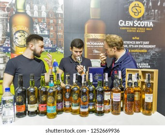KIEV, UKRAINE - OCTOBER 20, 2018: Presenters work at Glen Scotia Scotch highland single malt whisky booth at 4th Ukrainian Whisky Dram Festival organized by Good Wine company in Artistic Arsenal.