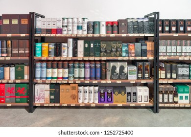 KIEV, UKRAINE - OCTOBER 20, 2018: Old, rare and luxurious Single Malt Scotch Whisky bottles on store shelves in rows at 4th Ukrainian Whisky Dram Festival by Good Wine company in Artistic Arsenal.