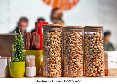 KIEV, UKRAINE - OCTOBER 20, 2018: Hazelnut, cashew and almonds nut varieties at 4th Ukrainian Whisky Dram Festival organized by Good Wine company in Artistic Arsenal.