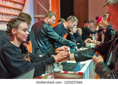 KIEV, UKRAINE - OCTOBER 20, 2018: People work on reception of 4th Ukrainian Whisky Dram Festival organized by Good Wine company in Artistic Arsenal Center.