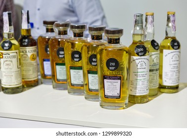 KIEV, UKRAINE - OCTOBER 20, 2018: Independent bottler Signatory whisky bottles in a row at booth of 4th Ukrainian Whisky Dram Festival by Good Wine company in Artistic Arsenal.