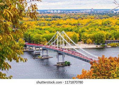 KIEV, UKRAINE - October 2017: Autumn in Kiev. Aerial view of pedestrian suspended bridge across the rive Dnipro in Kiev, Ukraine