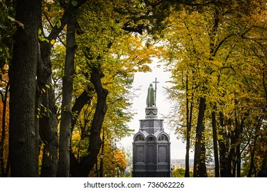 KIEV, UKRAINE - October 2017: Autumn in Kiev park. Saint Vladimir Monument view through yellow tree foliage in Vladimir park in Kiev center, Ukraine