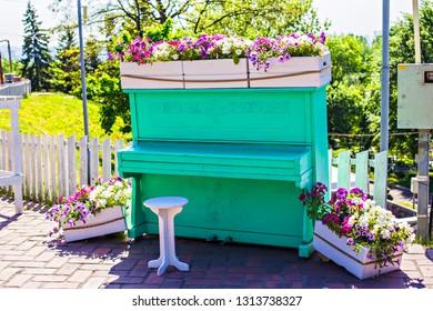 KIEV, UKRAINE - October 2017: Green decorative piano with colorful flower pots on it, flowers expo in  Kiev, Ukraine