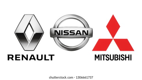 Kiev, Ukraine - October 22, 2018: Logos of car manufacturers alliance: Renault, Nissan, Mitsubishi, printed on white paper