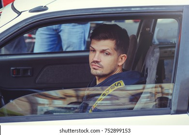 Kiev, Ukraine - October 22:  racer in the car.  automobile slalom and drift competitions in the city center, car on the road with cones in  Kiev, Ukraine.