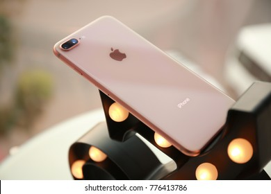 KIEV, UKRAINE - OCTOBER 25, 2017: Modern gold iPhone 8 plus on decorative stand