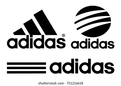 Kiev, Ukraine - October 27, 2017: Collection of Adidas logos printed on white paper. Adidas is a German multinational corporation, that designs and manufactures shoes, clothing and accessories