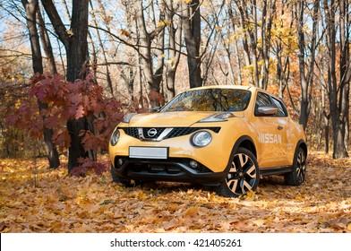 Kiev, Ukraine - October 30, 2015: Yellow Nissan Juke in the autumn park