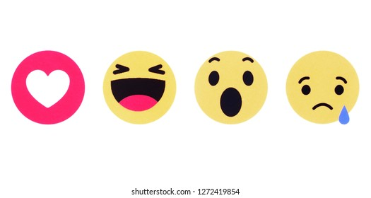 Kiev, Ukraine - October 31, 2018: Facebook like button and Empathetic Emoji Reactions printed on white paper. Facebook is a well-known social networking service.