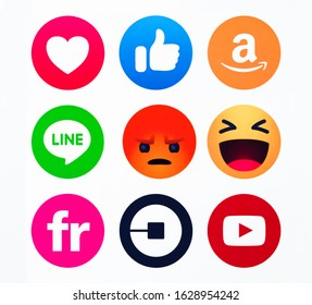 Kiev, Ukraine - Octoberber 09, 2019:  Like button  Empathetic Emoji reactions, Line, Uber, YouTube, Amazon, Flickr printed on paper.