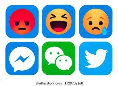 Kiev, Ukraine - Octoberber 09, 2019:  Set of most popular social media icons: New Facebook, like button  Empathetic Emoji reactions, Twitter, Messenger, WeChat printed on paper.