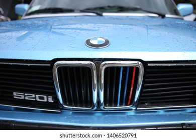 Kiev, Ukraine, on May 11, 2019. Sport nostrils of the car BMW E28 520i. A car with an injection engine in rainy weather.
