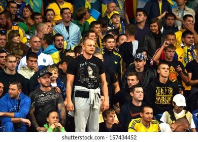 KIEV, UKRAINE - SEP 10: Ultras Ukraine team at the stadium during the qualifying match 2014 World Cup between Ukraine vs England, 10 September 2013, NSC Olympic Stadium, Kiev, Ukraine