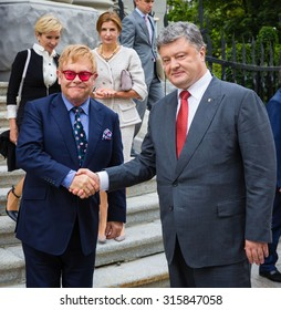 KIEV, UKRAINE - Sep 12, 2015: President Petro Poroshenko had a meeting with world-famous musician, composer and singer Elton John well-known in world for his charitable activity in fight against AIDS