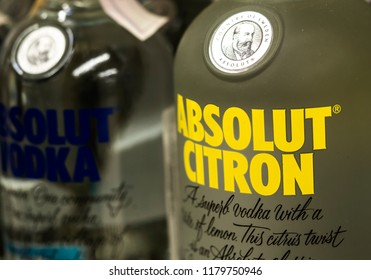 KIEV, UKRAINE - Sept 14, 2018: Absolute vodka bottles on store shelf. Swedish brand of vodka is the third largest brand of alcoholic spirits after Bacardi and Smirnoff.