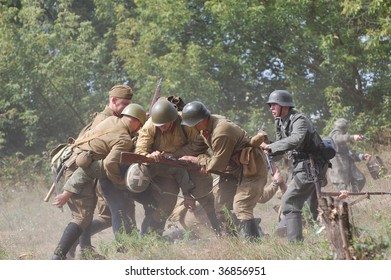KIEV, UKRAINE - SEPT 6, : Members of a history club wears a historical military uniforms as they participates in a WWII reenactment.Defense Kiev in 1941. September 6 , 2009 in Kiev, Ukraine