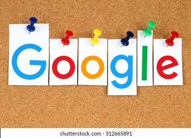 KIEV, UKRAINE - SEPTEMBER 02, 2015:New Google logotype printed on paper, cut and pinned on cork bulletin board.Google is USA multinational corporation specializing in Internet-related services