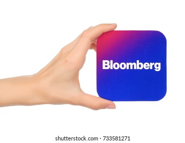 Kiev, Ukraine - September 04, 2017: Hand holds Bloomberg icon printed on paper. Bloomberg is an access to global business and finance news.