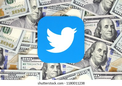Kiev, Ukraine - September 07, 2018: Twitter icon printed on paper and placed on money background. Twitter is an American online news and social networking service.